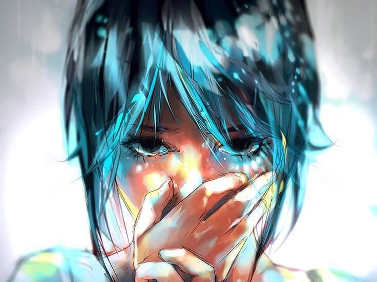 涙を流す青い髪の女性