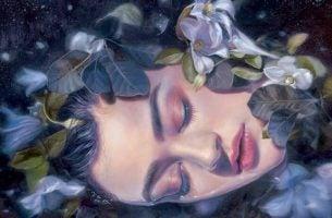花の中で眠る女性
