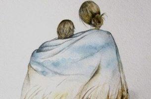 毛布にくるまる母と子