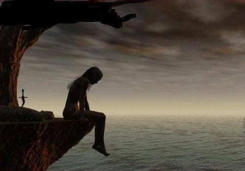 崖の上に腰掛ける女性