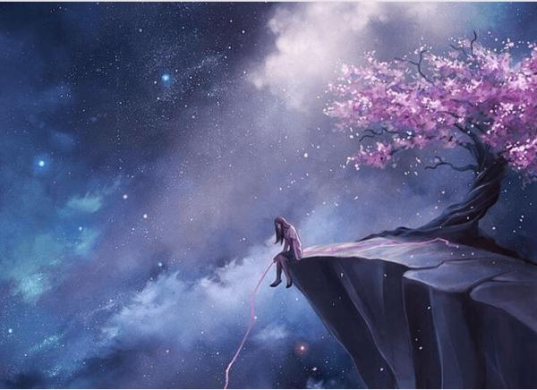 桜の咲く崖に座る女性