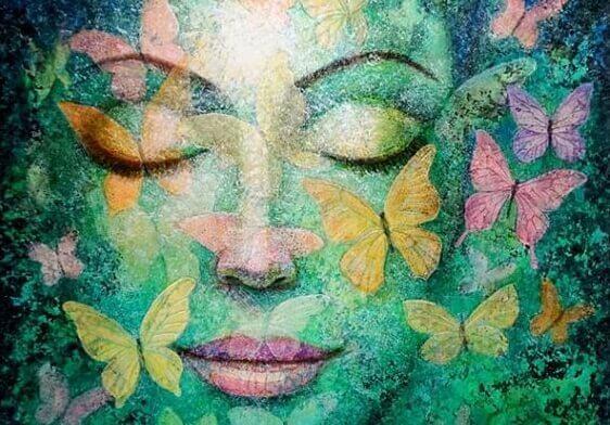 緑の女性の顔と蝶