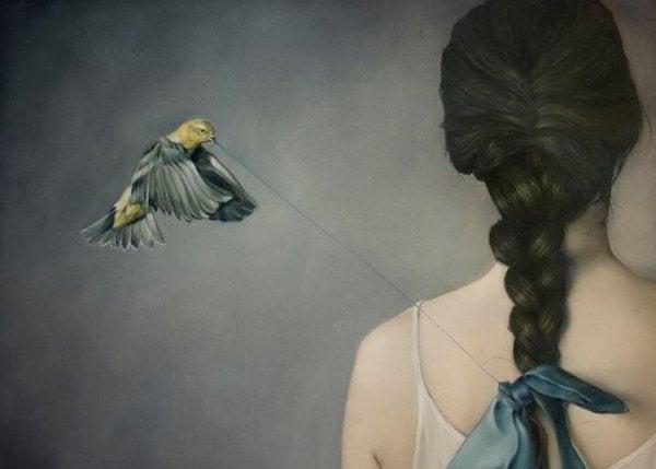 糸を引っ張る鳥