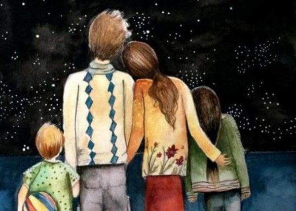 夜空を見る家族