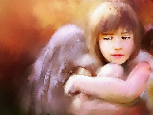 膝を抱える天使
