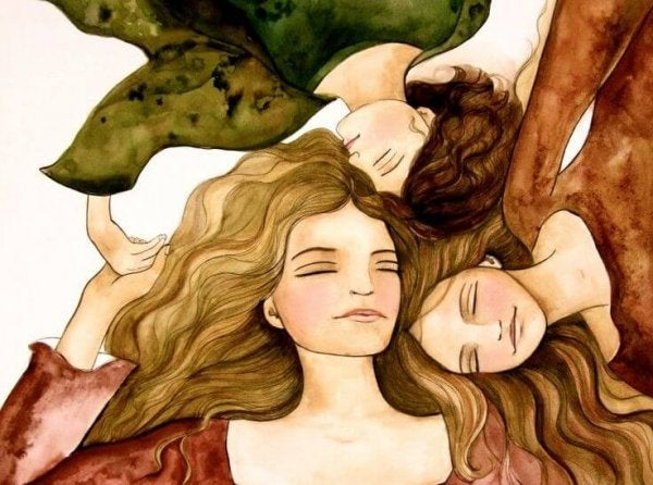 頭を寄せ合う3人の女性