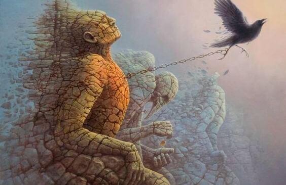 鳥に引っ張られる石像