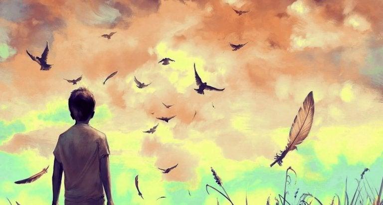 鳥を眺める少年