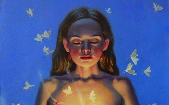 光の蝶を持つ女性