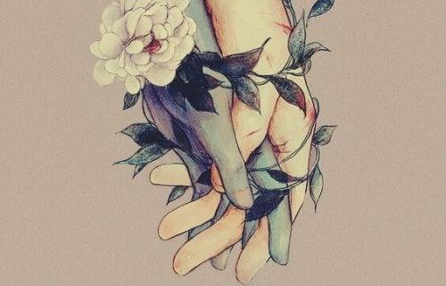 手に絡む花