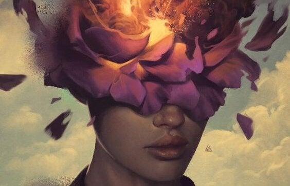 目と頭が花に覆われた女性
