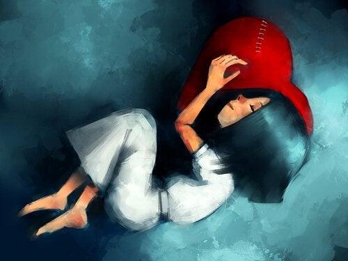 ハートの枕で眠る少女