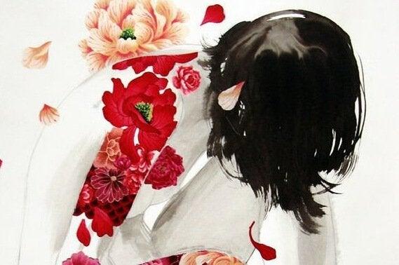 花柄の服を着た女性のお辞儀