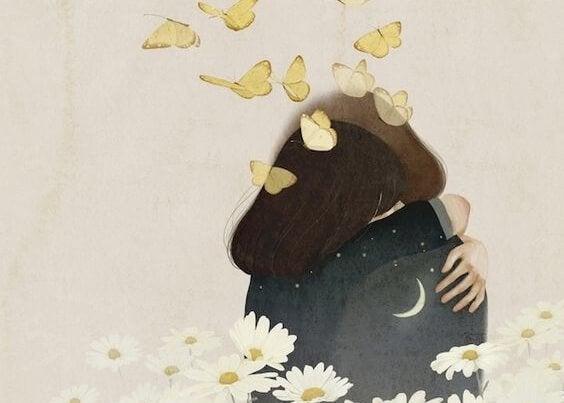 黄色い蝶が舞う中のカップルのハグ