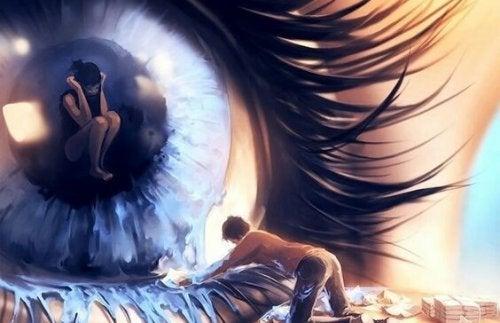 目の中にいる女性と涙を拭く男性