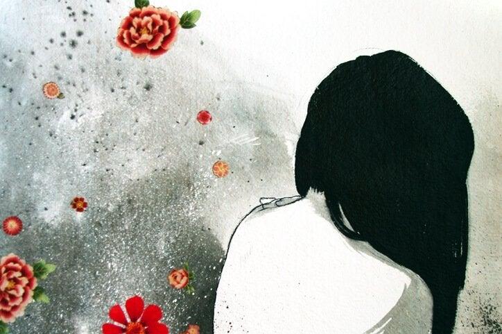 後ろ姿の女性と赤い花