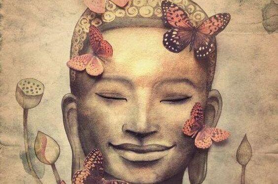 仏の顔に集まる蝶