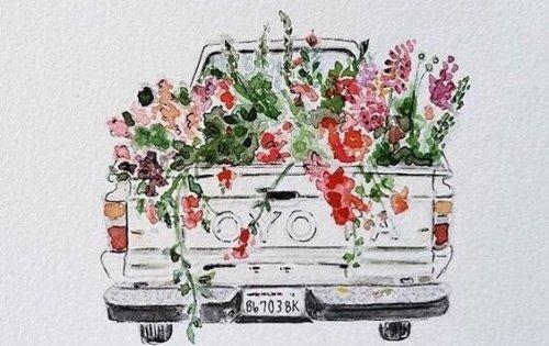 花がたくさん積まれたトラック