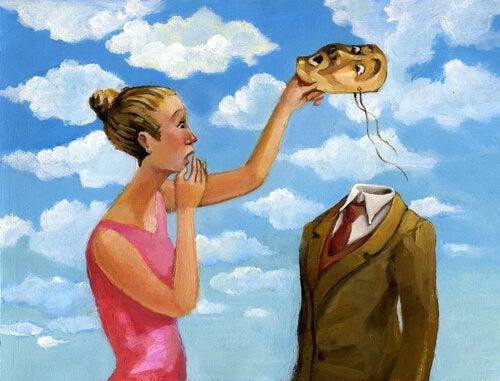 女性が男性の仮面を取る