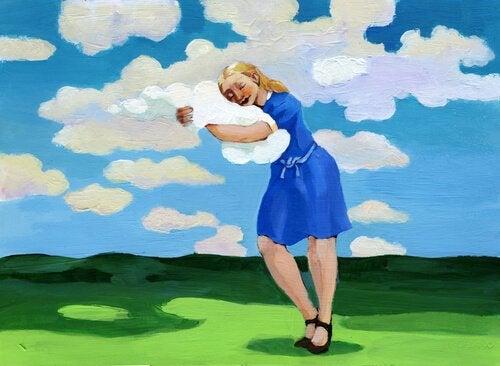 雲に抱きつく女性