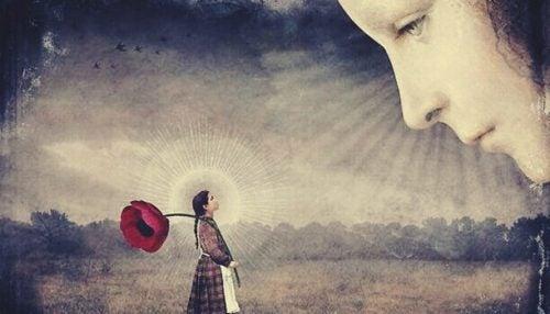 大きなバラを持つ少女を見る顔