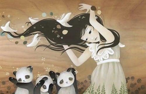 女性とパンダ