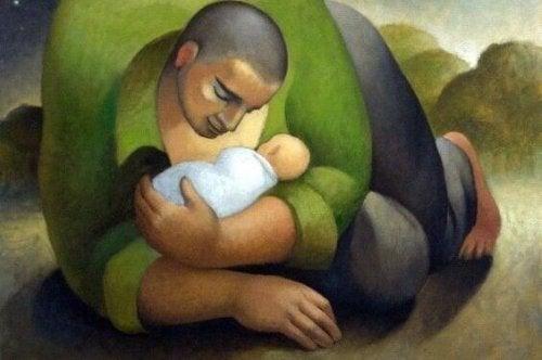 子どもを抱く男性