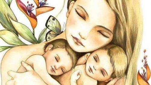子どもを抱く女性